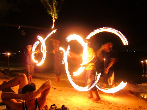 Fire jugglers lighting up Koh Tao's beaches at night.