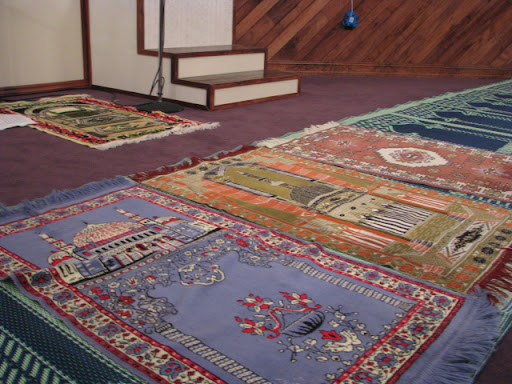 Colorful prayer carpets line the prayer hall in the mosque. (Photo credit: Jennifer Moore)