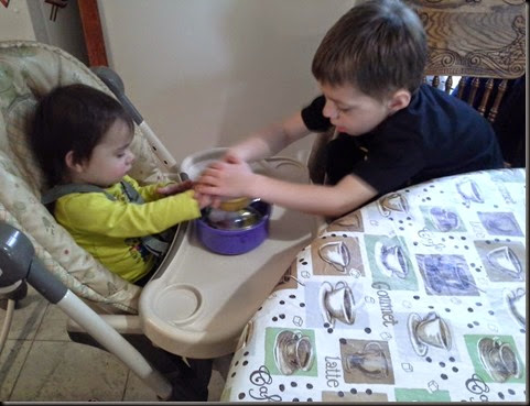 Aidan and Miranda coloring eggs 2