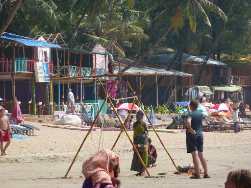 Goa beach, where the more inventive touts bring have a mobile high wire and well trained children.