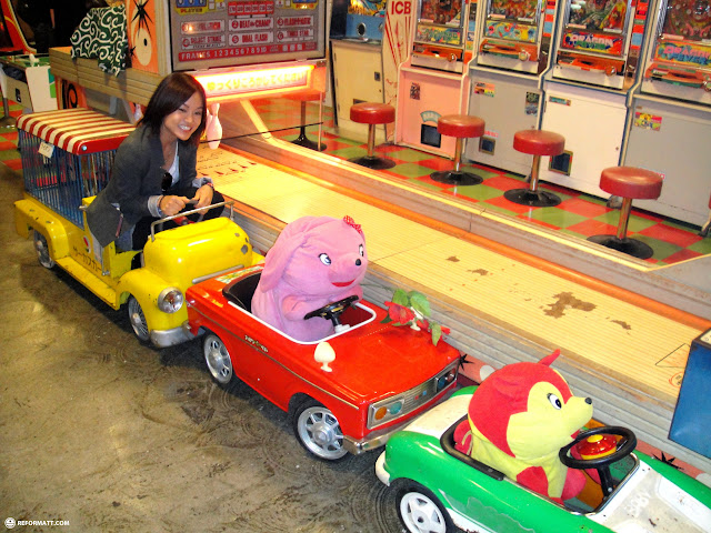yuka chasing the stuffed animal villains around at muscle park in odaiba in Odaiba, Tokyo, Japan