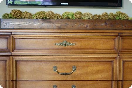 wooden trough under tv