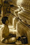 Bangkok - Light on the Woman Praying to Buddha