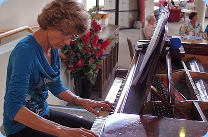 Denise Gunson playing the grand piano in a finale mini-Concert. Photo courtesy of Dennis Lyons