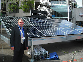 Ford vehicle electrification director Mike Tinskey with SunPower solar panels as the automaker promoted its 100% pure battery Focus Electric at Justin Herman Plaza in San Francisco on March 28. Retail deliveries of the $39,000 sedan are to commence in April. The 147-square-foot SunPower array is available for about $10,000, Tinskey says -- and far less in states with purchase incentives.