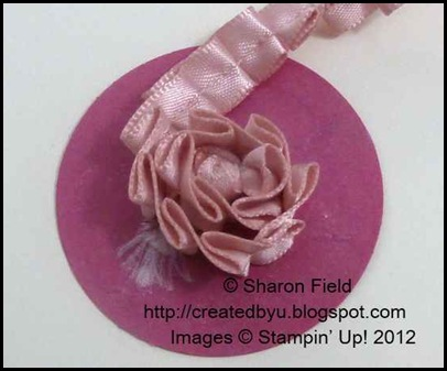 Stand pleated satin ribbon on edge as you wrap onto card stock circle