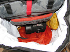 Sleeping bag in silnylon sack and pressed down - Jetboil on top near back