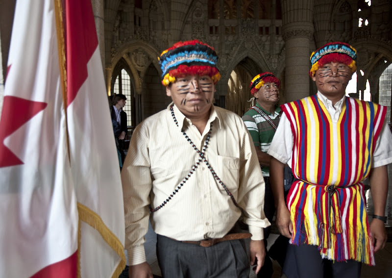 Peas Peas Ayui, Puwaanch Kintui Antich,  Ampush Ayui Chayat  and Jiyukam Irar Miik stood in the grand hall of the Canadian Parliament on April 25, 2012.