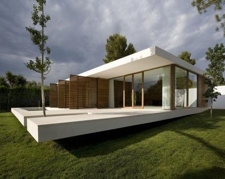 Casa de estilo minimalista con piscina en espa a arquitexs for Pisos para casas minimalistas