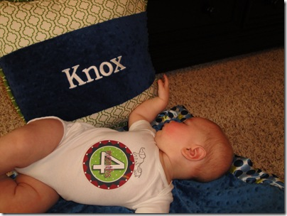 23.  Knox playing with pillow