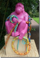 pink ape with rope