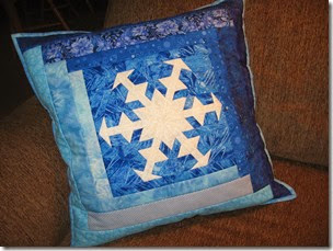 Snowflake log cabin style pillow