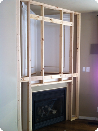 A fireplace redo from thrifty decor chick for Building a corner fireplace
