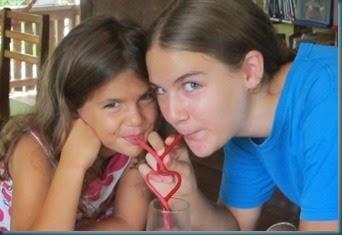 Sarah & Kathering drinking through heart straw SAT 2-14