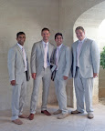 Groomsmen attending a destination wedding in Turks and Caicos looked beach-chic in light-colored suits and pink ties.