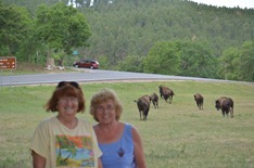 Sue and Mo, with stampeding buffalo behind us!