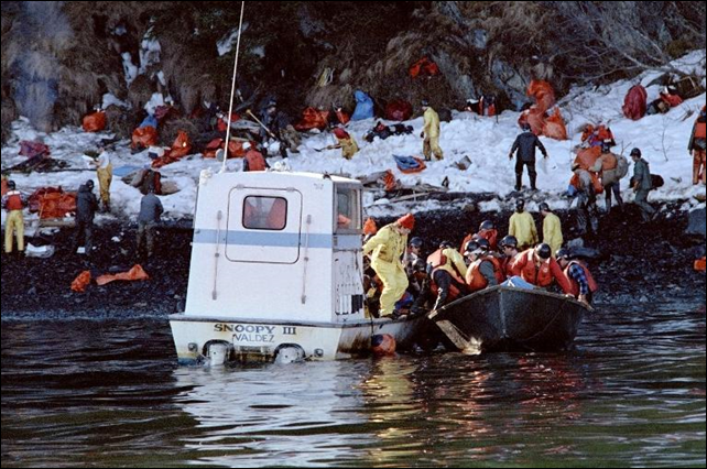 Oil spill cleanup workers are transported by a small boat, named 'Snoopy III', to Naked Island on Prince Williams Sound, during the Exxon Valdez disaster, on 2 April 1989. Photo: Chris Wilkins / AFP