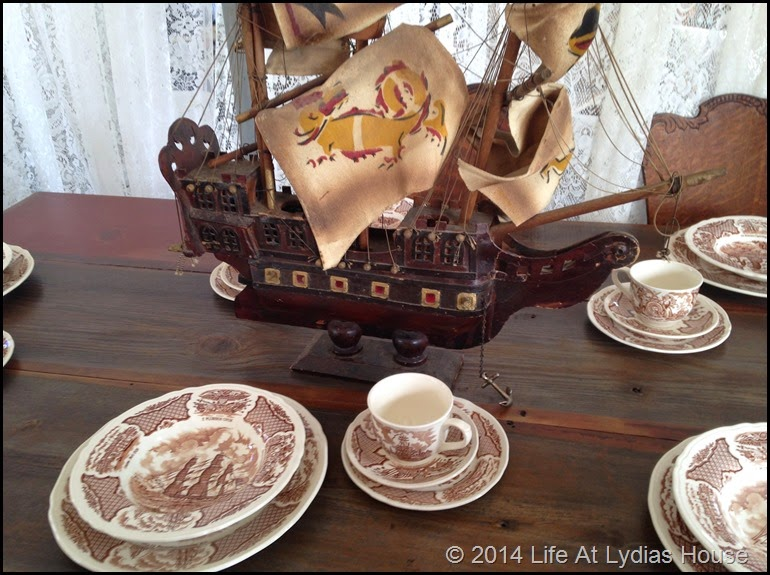 Round top table with shipping transferware and ship centerpiece via Life At Lydias House