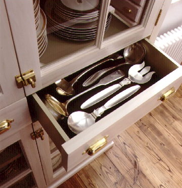 Silverware organizers don't always fit larger items, so Martha likes to lay these flat in a drawer lined with protective material.