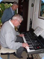 Alan Wilkins had a go on Gordon's Korg Pa3X with Michael Bramley watching on with interest.
