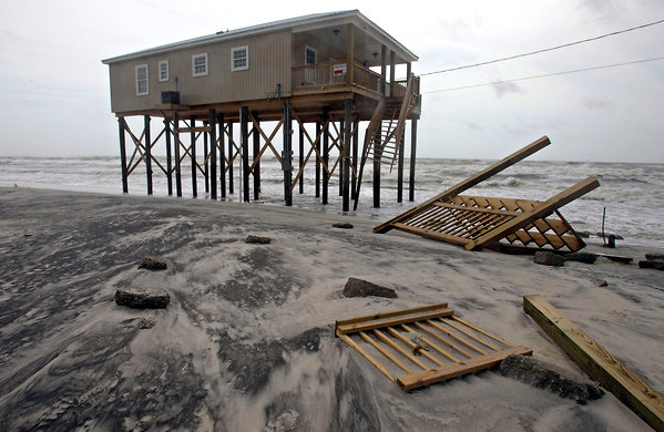 Over the years, many Dauphin Island homes have been elevated, as required by the modern building code, and they can now survive a moderate storm surge. But Hurricane Isaac did do some damage in August 2012, including to the staircase of this home. G.M. Andrews / Press-Register via Associated Press