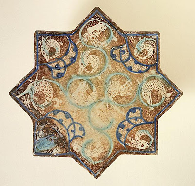 Star Tile | Origin: Iran, probably Takht-i Sulyaman | Period:  about 1270-1280 | Collection: Art Museum Council Fund (M.68.22.8) | Type: Ceramic; Architectural element, Fritware, overglaze luster-painted with turquoise and cobalt blue, 1/2 x 7 7/8 in. (1.27 x 20 cm)