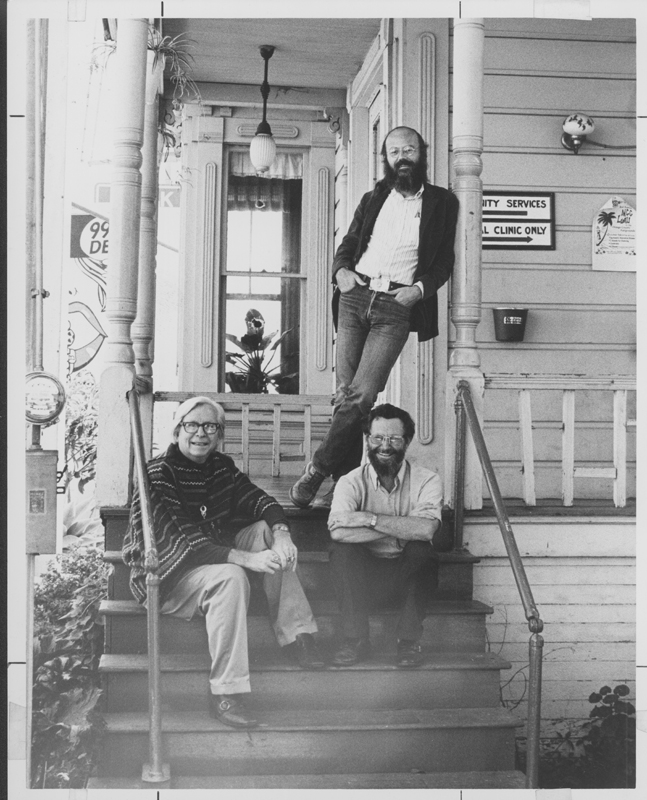 Don Kilhefner (standing), Morris Kight (left), and Ken Bartley on the porch of the first home of the Los Angeles Gay Community Services Center. Appeared in the Advocate issue 149, October 23, 1974. Circa 1974.