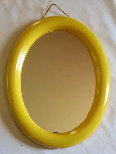 Yellow plastic framed mirror front