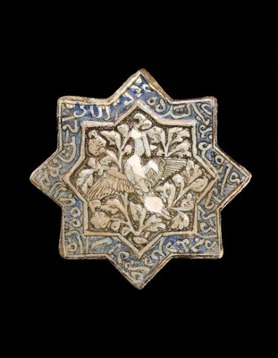 Tile | Origin:  Sultanabad,  Iran | Period: 14th century  Il-Khanid period | Details:  Not Available | Type: Stone-paste painted under clear glaze | Size: H: 20.7  W: 20.8  cm | Museum Code: F1973.15 | Photograph and description taken from Freer and the Sackler (Smithsonian) Museums.