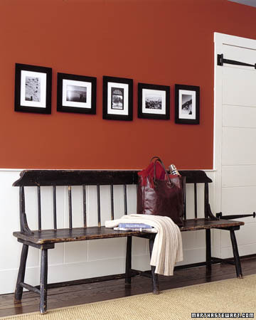 Give a grouping of horizontal and vertical photos a chic, cohesive look -- and add interest to a long wall in a hallway or above a sofa or bench. Use the same frame and mat for each, then hang pictures along the same center line, spacing each two inches apart. Alternate horizontal and vertical pictures, using the latter at the ends.