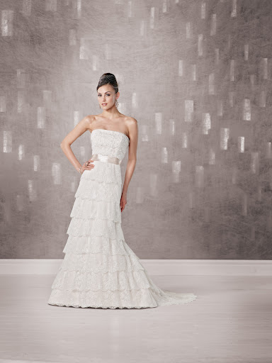 The silk ribbon on this layered lace Kathy Ireland gown adds a nice contrast.
