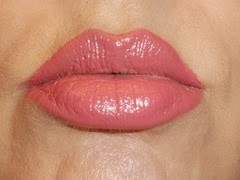 wearing longlasting lipstick in love me from essence cosmetics
