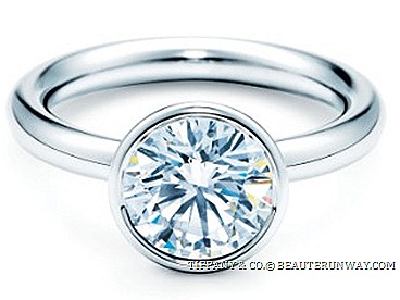 TIFFANY & CO. SETTING BEZET ® DIAMOND ENAGEMENT RING WEDDING BAND natural contours diamond accentuates its shape streamlined platinum bezel setting. Aviliable in heart shaped, round brilliant, princess-cut pear shaped