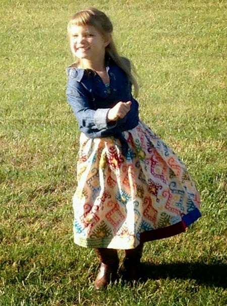 Isabel in her limited edition Showcase Your Style dress by Daydream Believers Designs