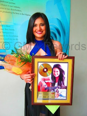 Julie Anne San Jose with her gold record award