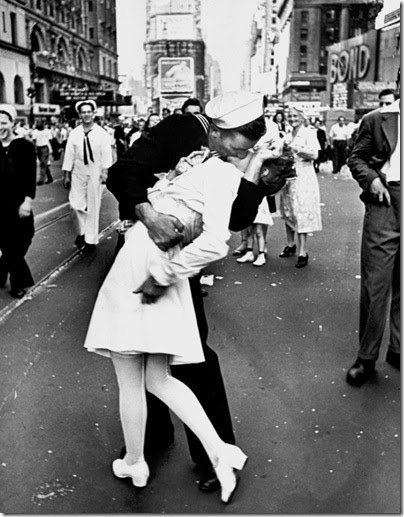 A jubilant American sailor clutching a white-uniformed nurse in a back-bending, passionate kiss as he vents his joy while thousands jam Times Square to celebrate the long awaited-victory over Japan.  (Photo by Alfred Eisenstaedt//Time Life Pictures/Getty Images)