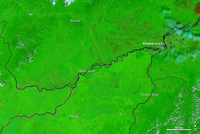 Satellite view of the Amur River near Khabarovsk in eastern Russia, 21 August 2008. In the city of Khabarovsk, the Amur River swelled to a record height of 696 centimeters (274 inches) on 21 August 2013, the worst flood in Russia's history according to Alexander Frolov, chief forecaster of the national weather center. Photo: LANCE/EOSDIS MODIS Rapid Response Team / NASA GSFC