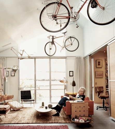 This photo was taken in the home of designer David Baker. He is making striking use of his high ceilings. (dwell.com)