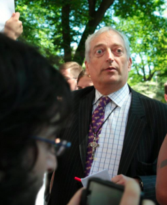 Antiscience campaigner Christopher Monckton watches protesters outside Heartland Institute's 2012 conference against climate science, 23 May 2012. thinkprogress.org