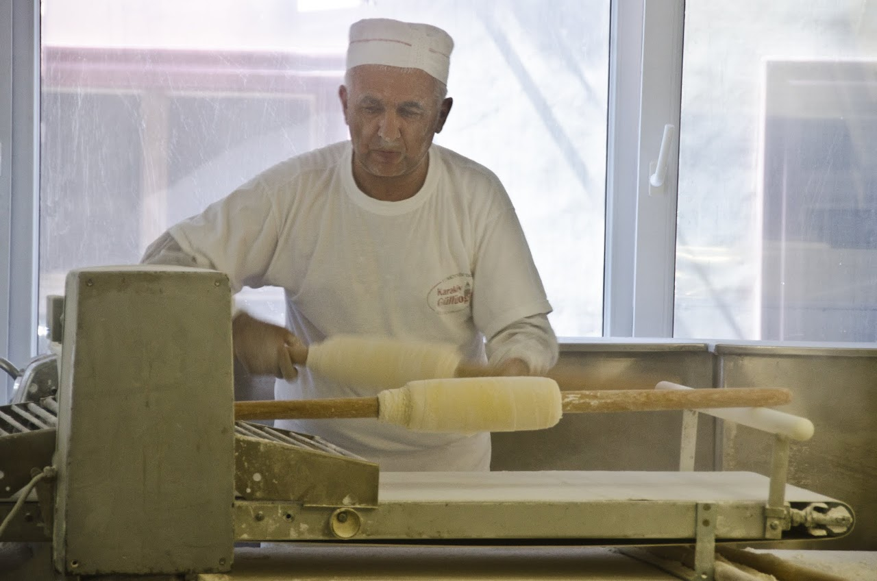 Baklava rolling by machine