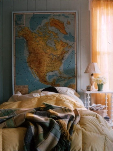 This headboard was made from an old schoolhouse map. (Martha Stewart Living, August 2002)