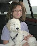 Addison holding Penelope a Labradoodle