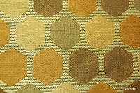 Tkanina ozdobna w geometryczne wzory. Na zasłony, poduszki, narzuty, dekoracje. Brązowa, złota, miedziana.