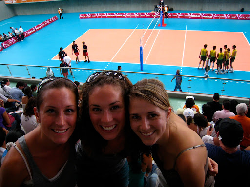 Marlo, Laura, and Marcela enjoying the Men's Volleyball game.
