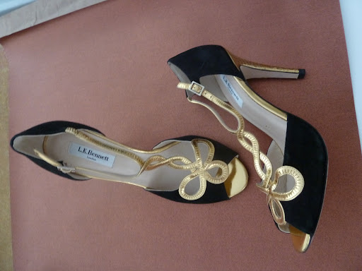 A black-and-gold pair of pumps by L.K. Bennett.
