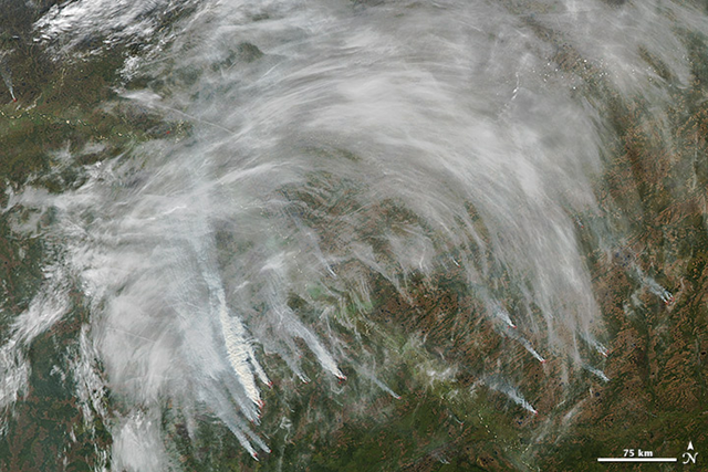 On 11 September 2012, NASA's Aqua satellite captured this image of fires burning in Tomsk, a region of south central Siberia where severe wildfires have burned throughout the summer. Thick smoke billowed from numerous wildfires near the Ob River and mixed with haze and clouds that arrived from the southwest. Red outlines indicate hot spots where MODIS detected the unusually warm surface temperatures associated with fires. NASA image courtesy Jeff Schmaltz, LANCE MODIS Rapid Response Team, Goddard Space Flight Center
