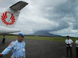 """No photos, Mister!"" Heavy military presence at Ranai Airport, Gunung Ranai in cloud (Dan Quinn, September 2013)"