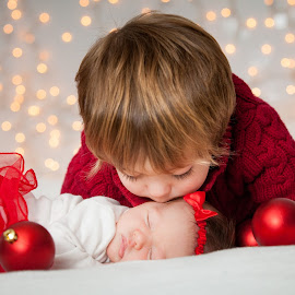 Christmas Sibling Love  by Mike DeMicco - Public Holidays Christmas ( babies, xmas, christmas, holidays, kids, siblings, bokeh, sister, lights, love, kiss, decorations, brother )