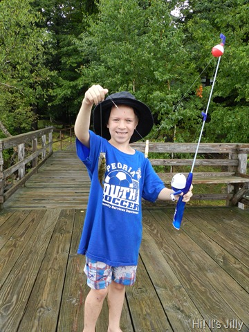 boy showing off fish he caught