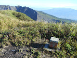 Cement marker on the peak directly above the ridge between the two active craters on Gunung Kaba (Dan Quinn, August 2013)